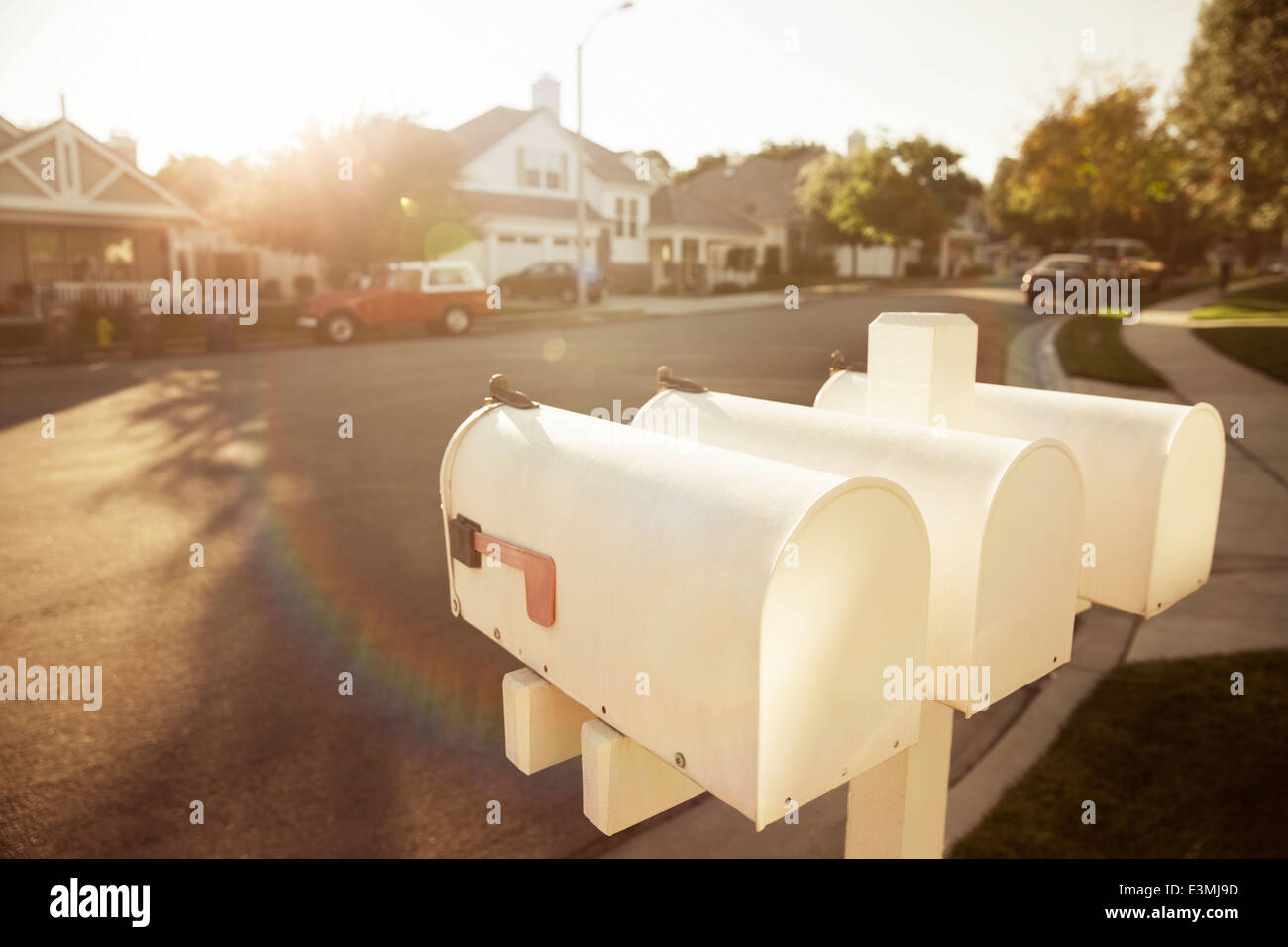Mailboxes on suburban street - Stock Image