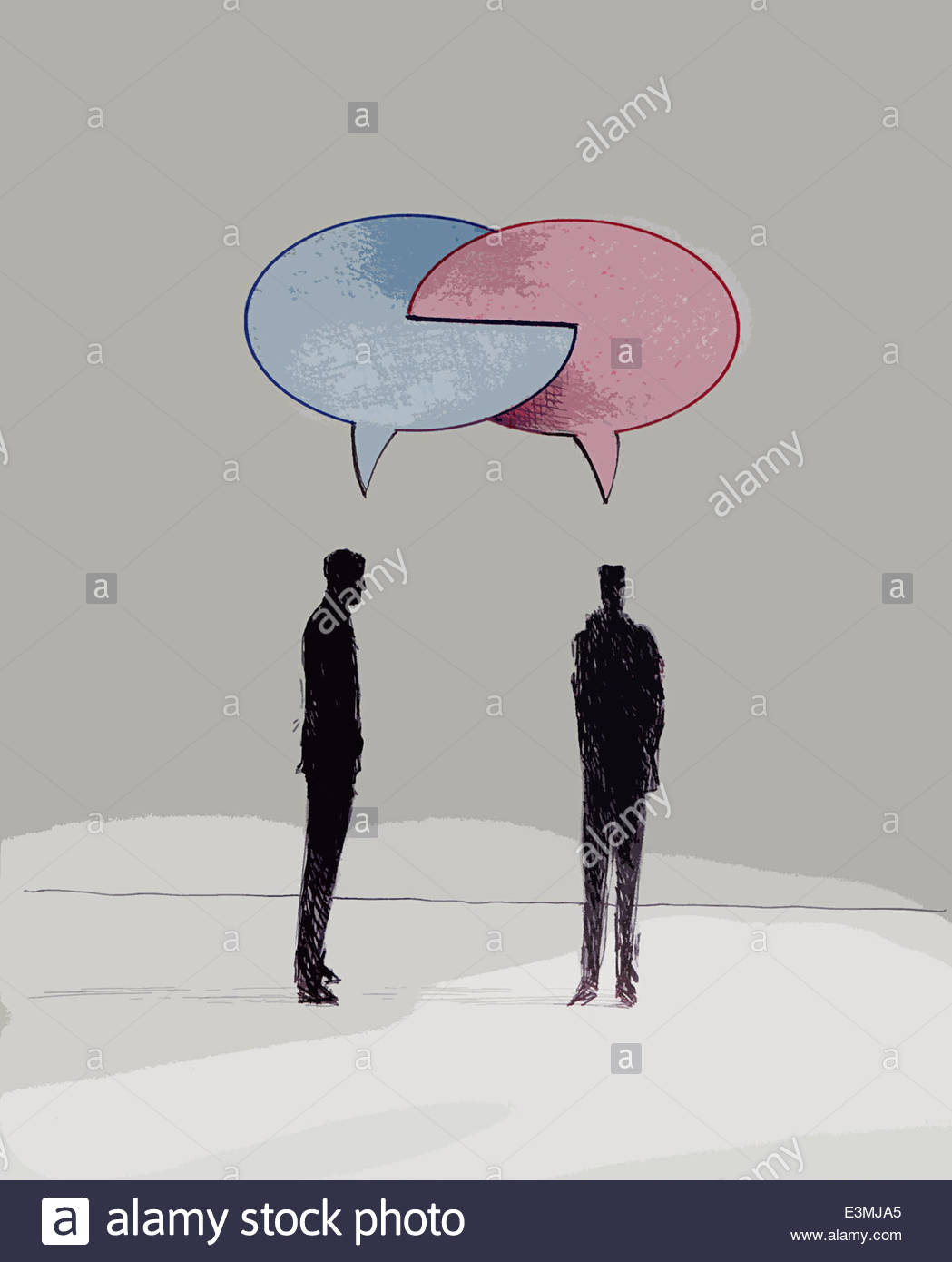 Connected red and blue speech bubbles above businessmen talking - Stock Image