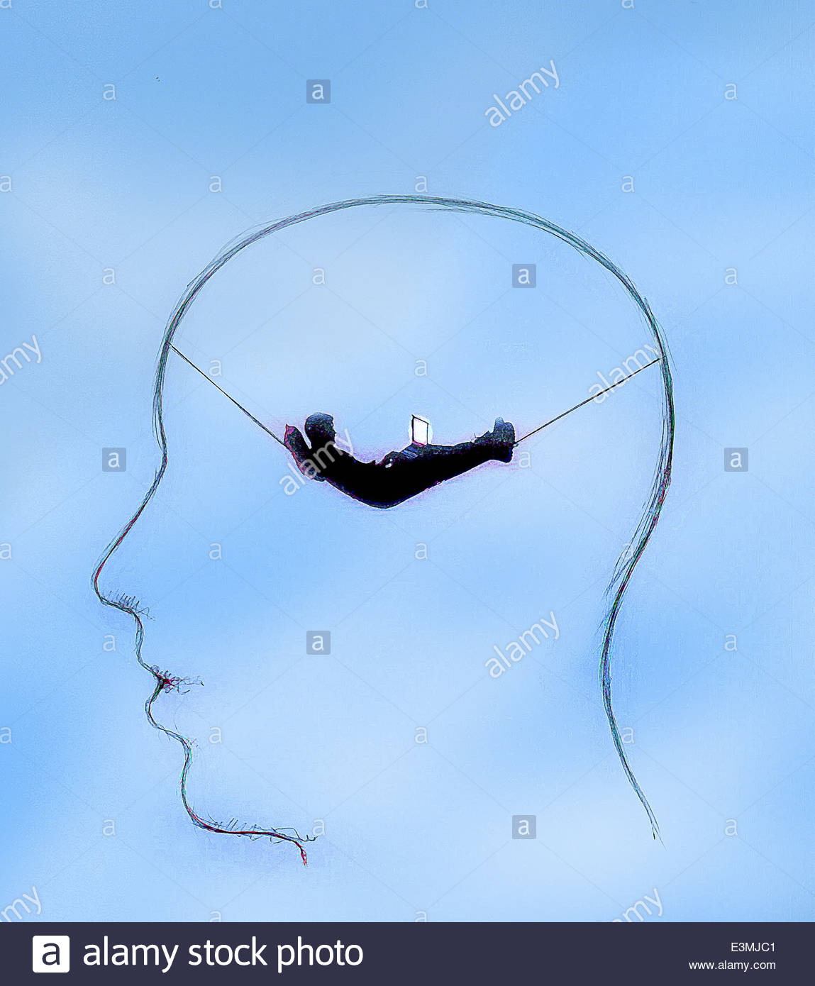 Businessman with laptop relaxing inside man's head - Stock Image
