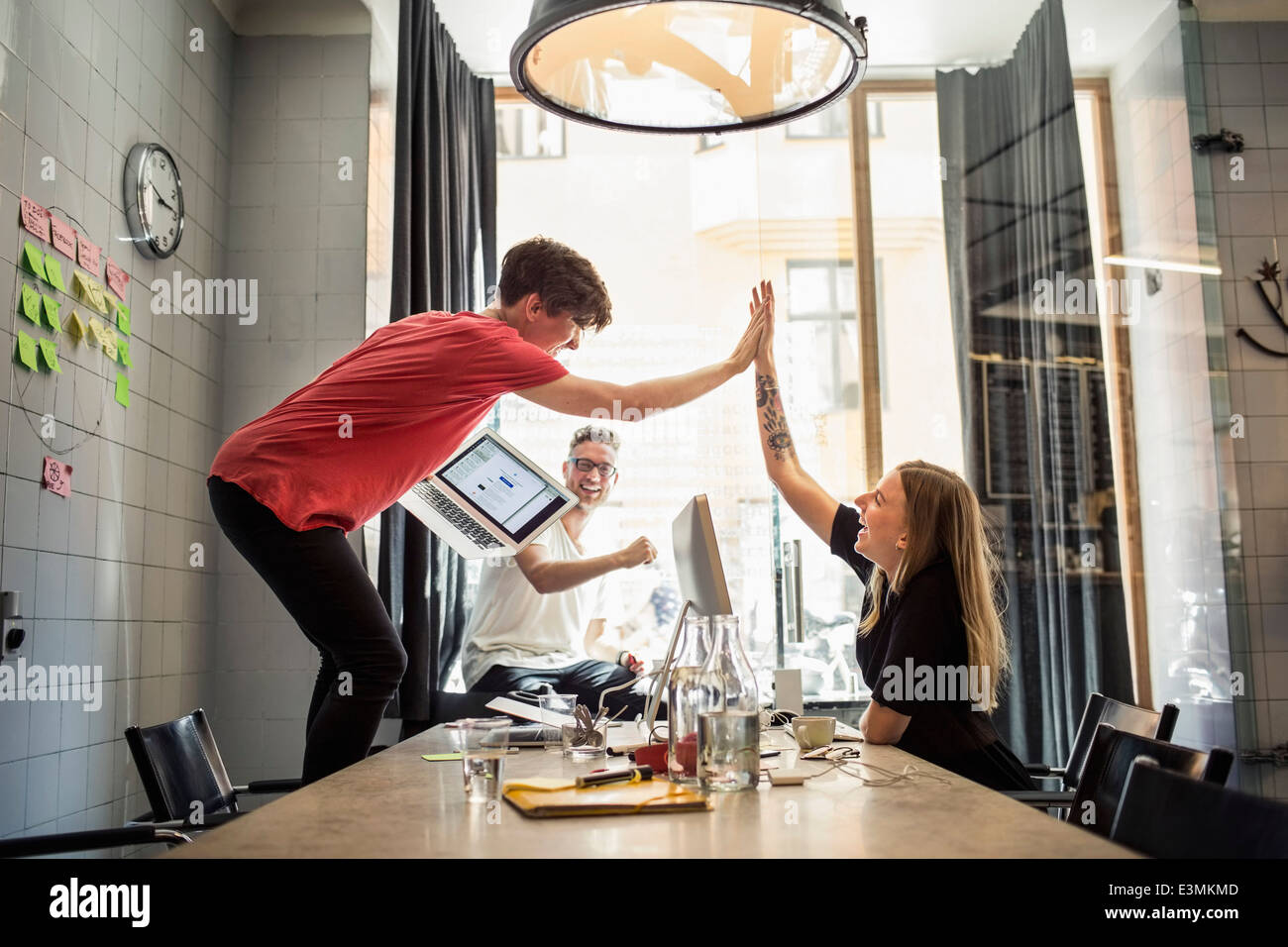 Successful team of new business people in creative office - Stock Image