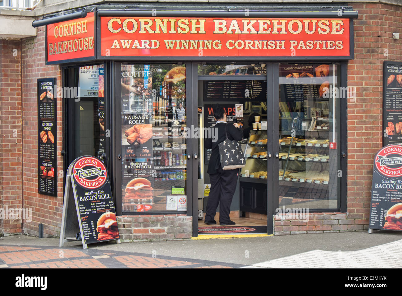 The front of a Cornish Bakehouse retail store & bakery in Swindon, Wiltshire,UK with a customer being served - Stock Image