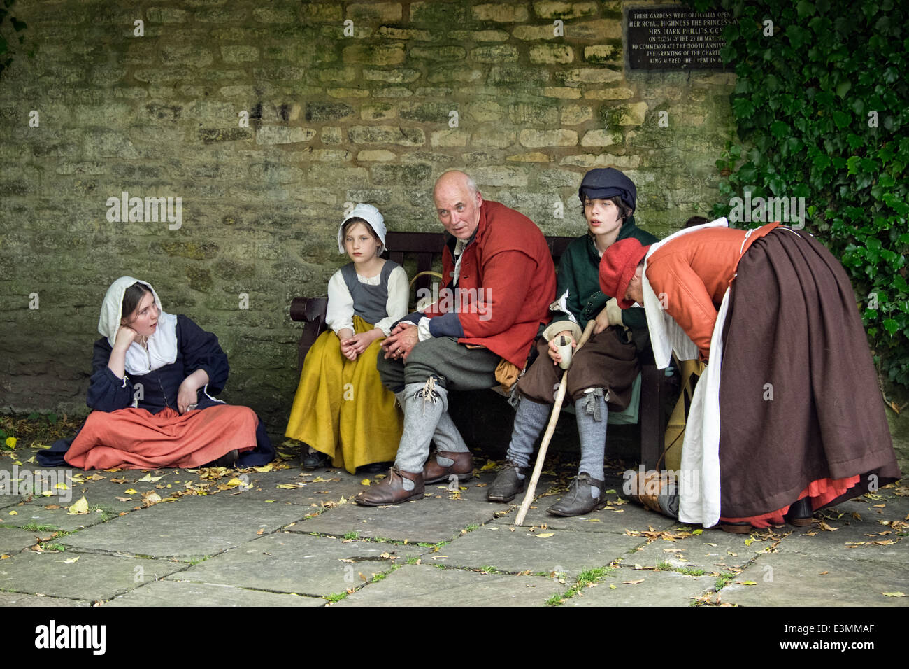 Reenactors portraying a family group of the English civil war period in 17th century costume - Stock Image