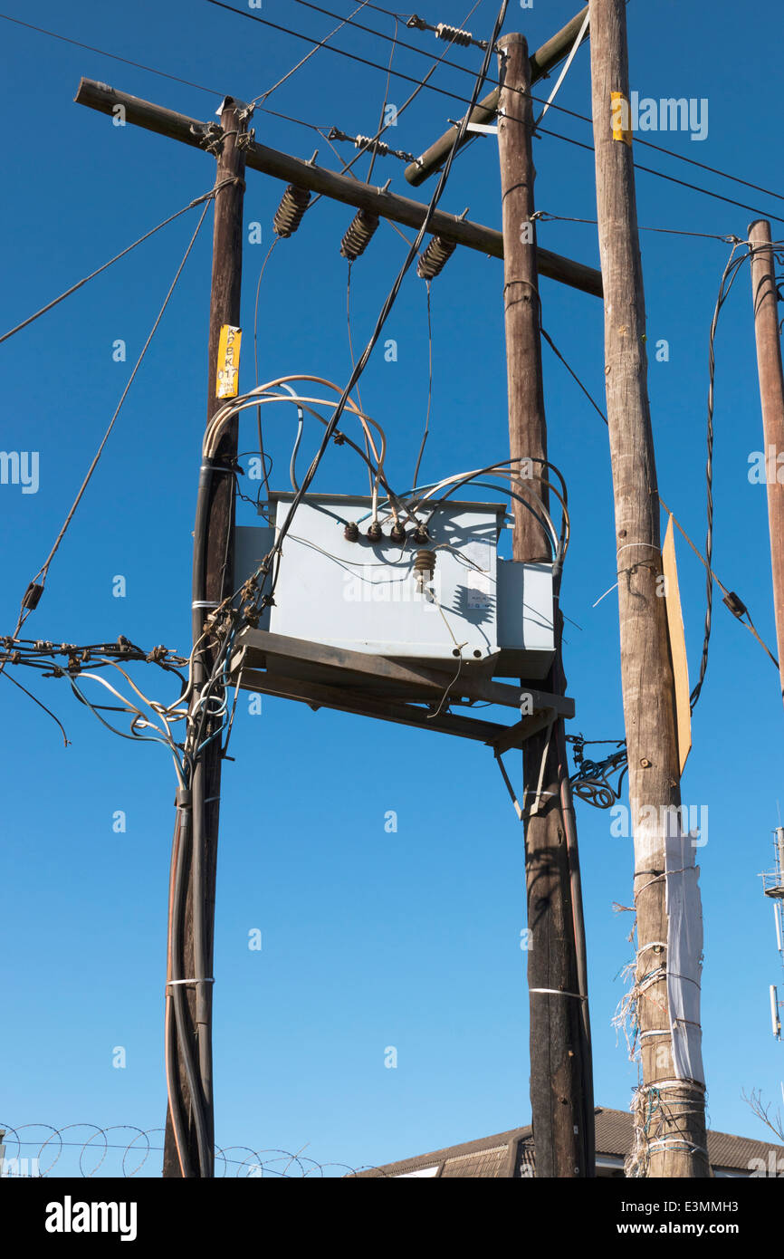 wooden poles and platform supporting electricity junction box - Stock Image