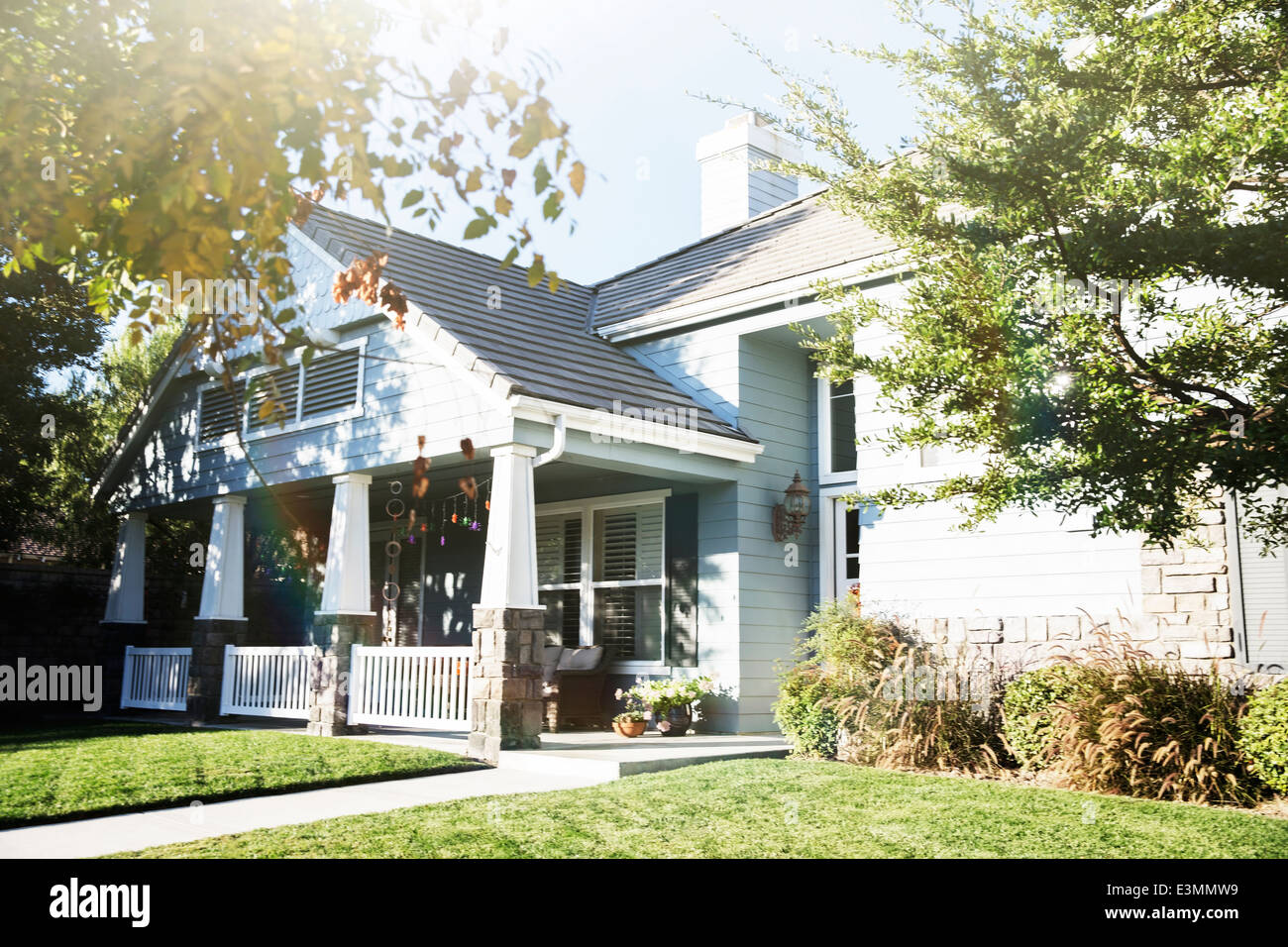 Sunny house and yard - Stock Image