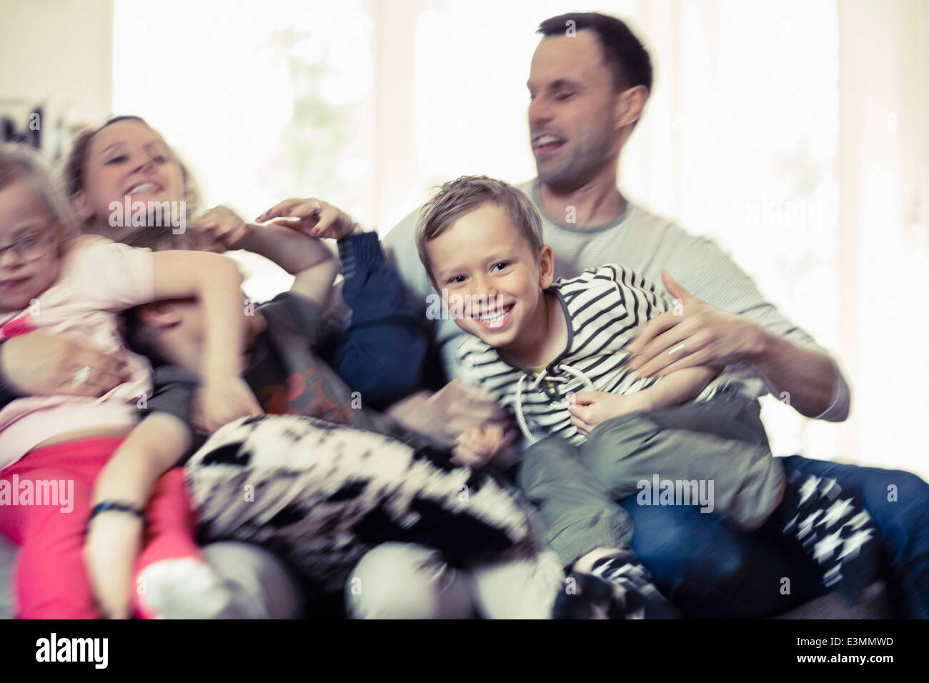 Happy family spending leisure time at home - Stock Image