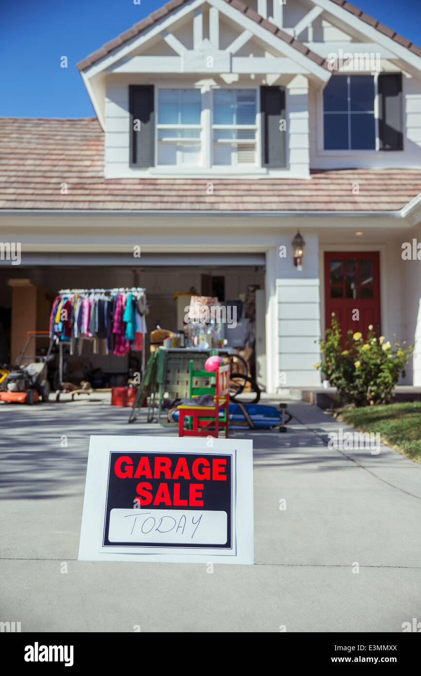 Garage Sale sign in driveway - Stock Image
