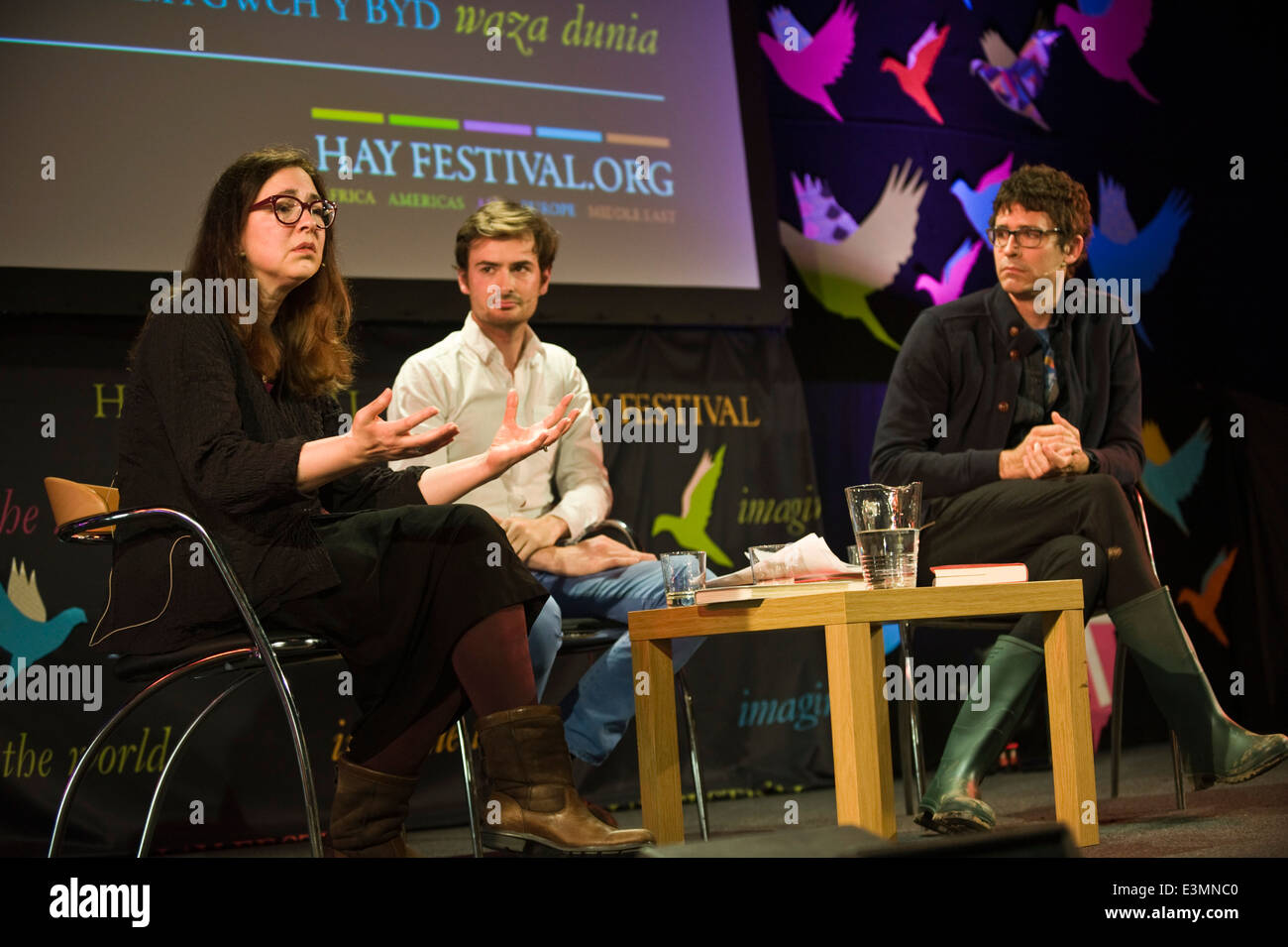 American authors Lorrie Moore (L) & Joshua Ferris (R) in discussion with Ted Hogkinson (C) at Hay Festival 2014 - Stock Image