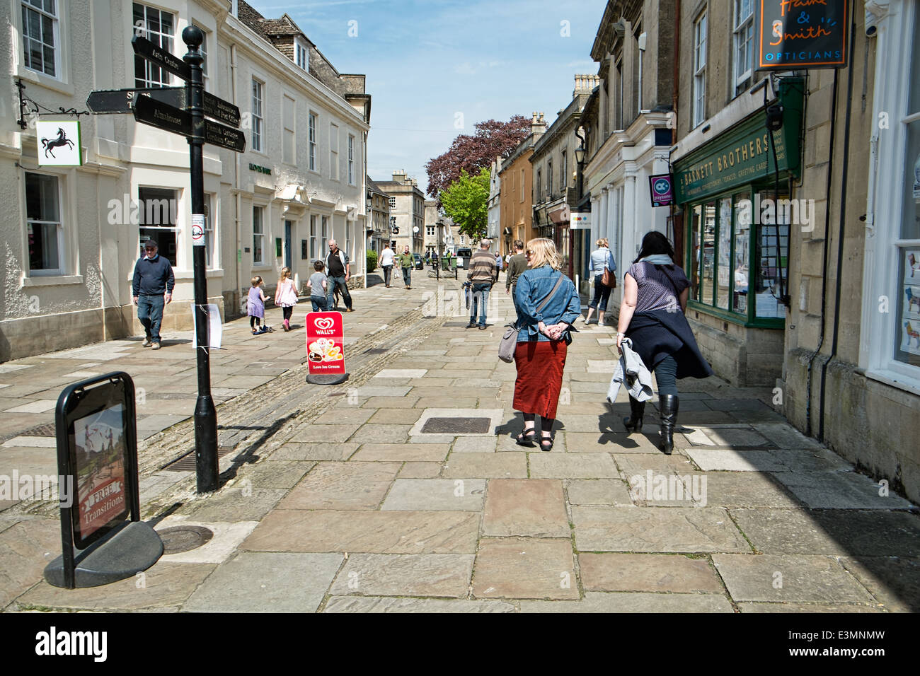 Visitors walking down the high Street in the town of Corsham, Wiltshire, Uk on a sunny day. Also a Location for Stock Photo