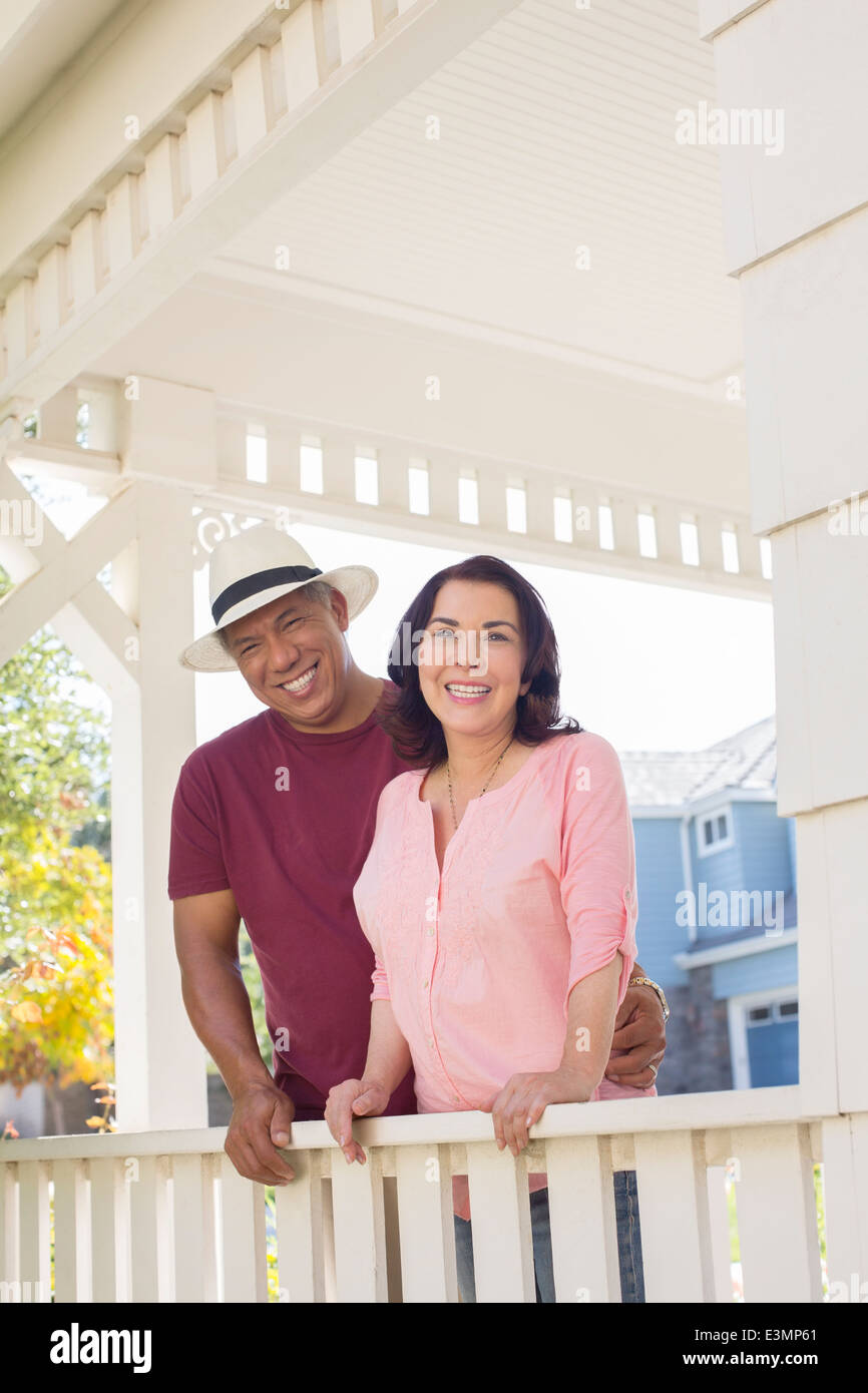 Portrait of happy couple on porch - Stock Image
