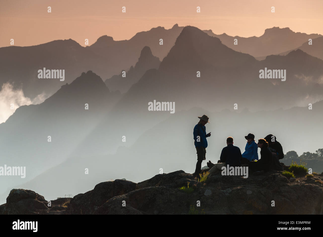 A group of trekkers relaxing on Shira Plateau, Kilimanjaro at sunset - Stock Image