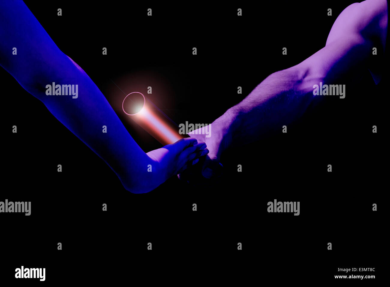 Male relay runner hands over the red baton to female runner. Blue filtered version - Stock Image