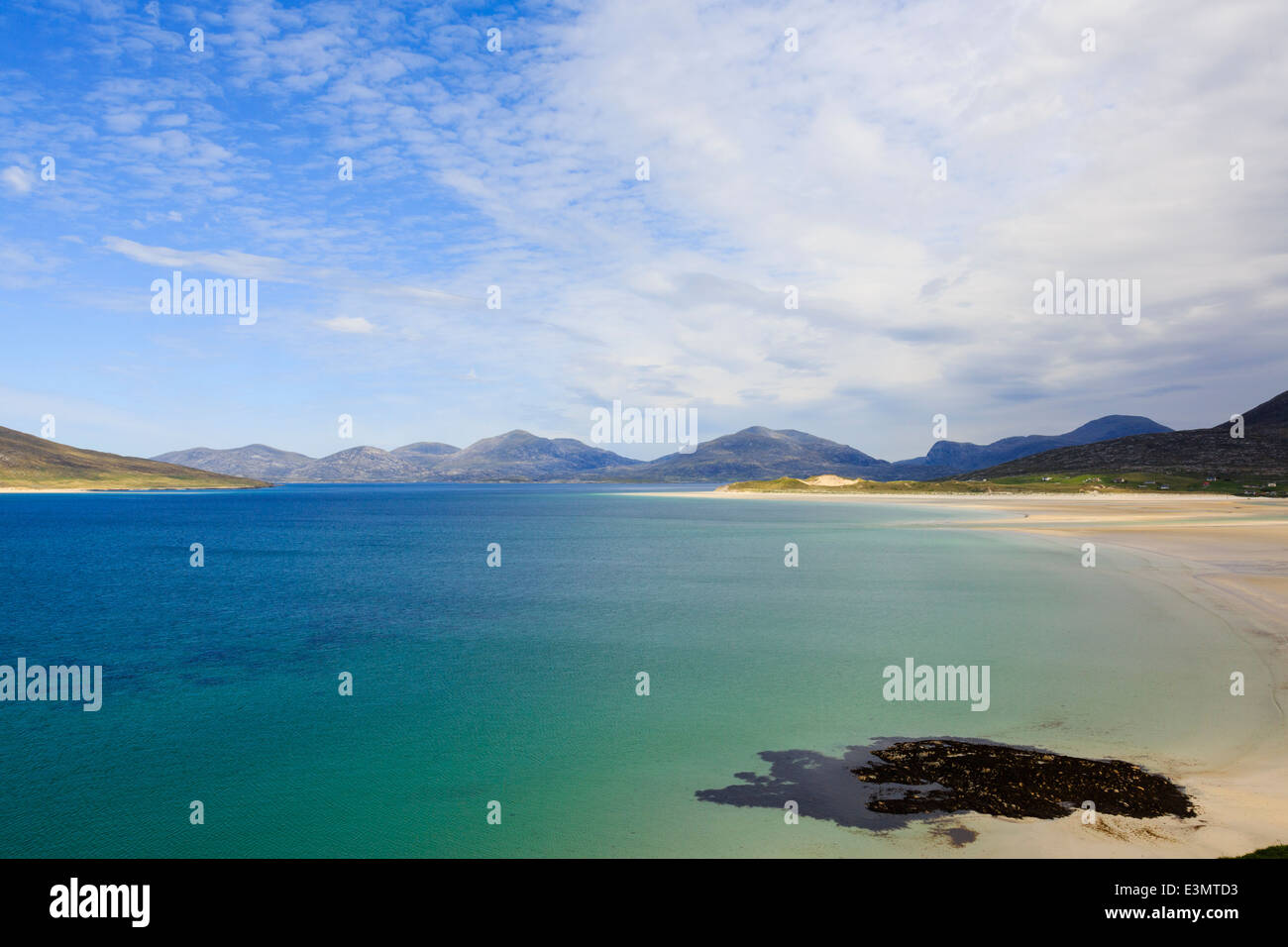 Looking across Sound of Taransay and Traigh Sheileboist beach to mountains of north Harris Outer Hebrides Western - Stock Image