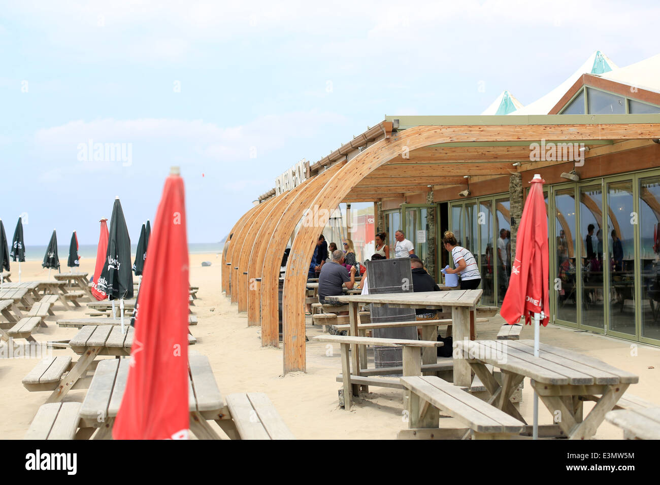 The Watering Hole pub on the beach at Perranporth, Cornwall - Stock Image