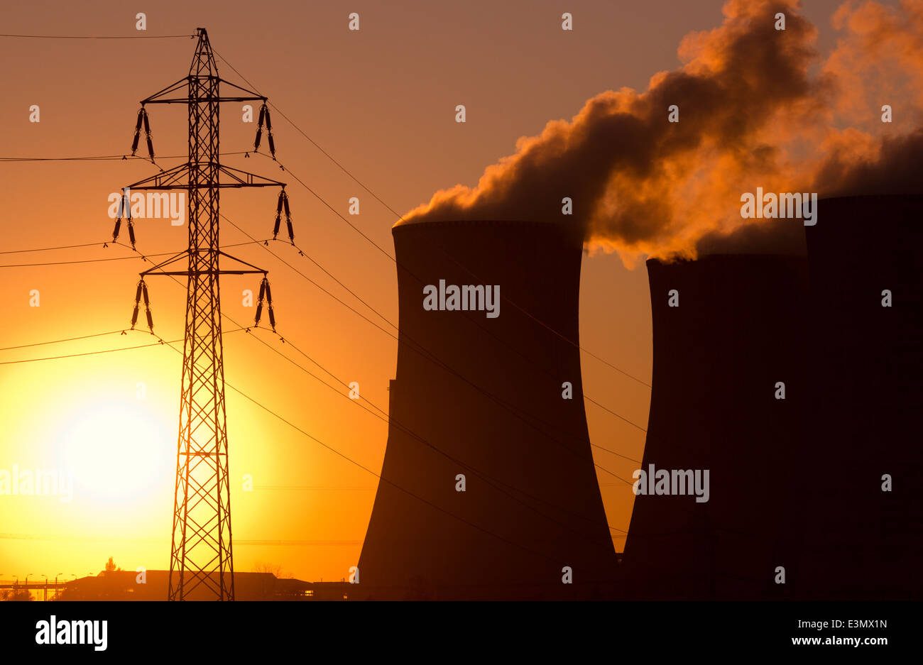 power plant at sunset - Stock Image