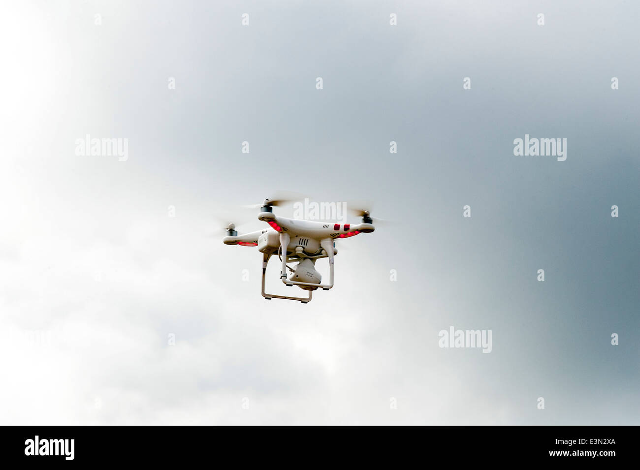 Radio remote controlled camera drone hovering in flight over Lough Foyle, Derry,Londonderry, Northern Ireland - Stock Image