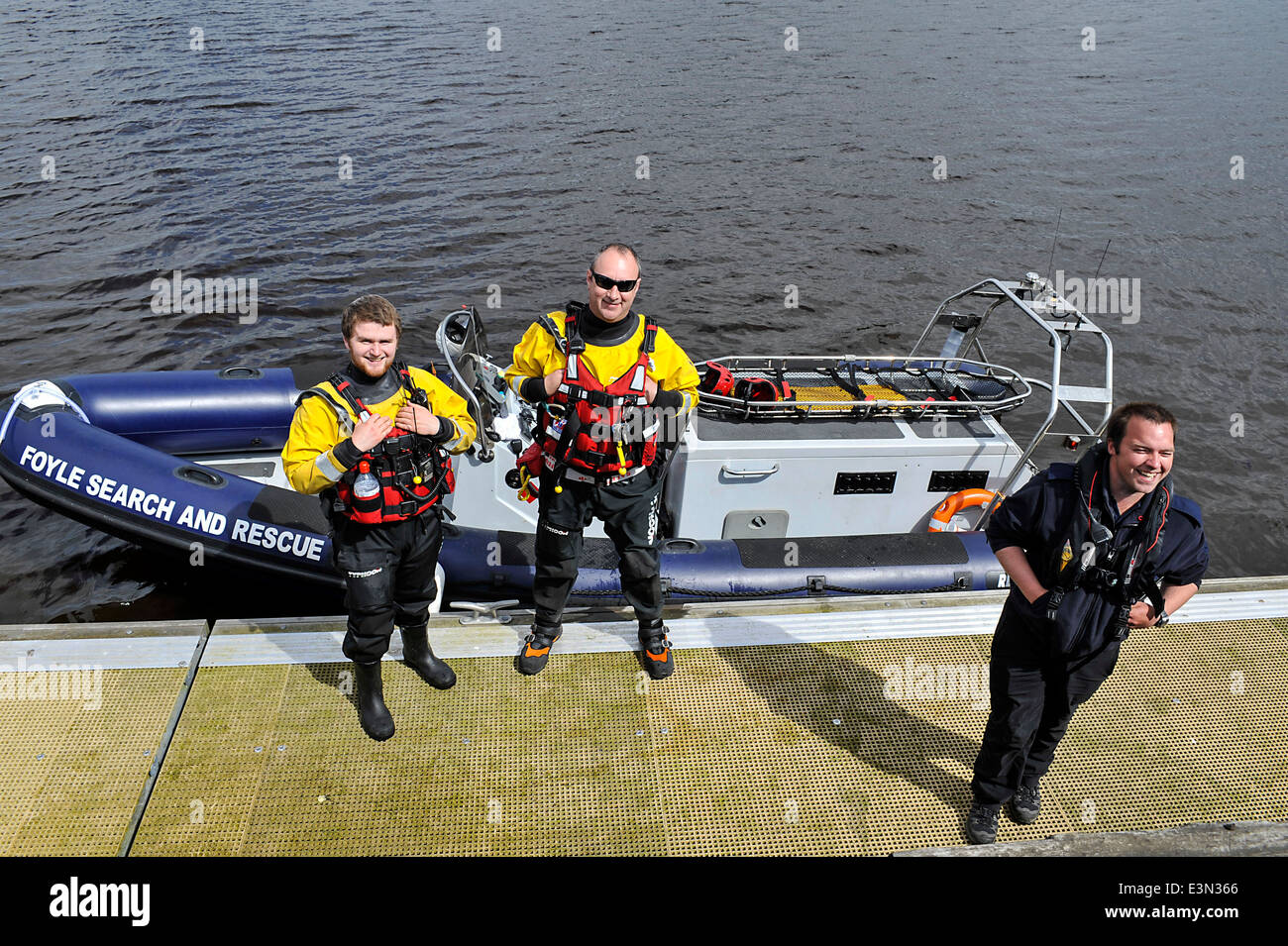 Crew members of the emergency Foyle Search And Rescue, wearing life jackets, on duty at the River Foyle, Derry, - Stock Image