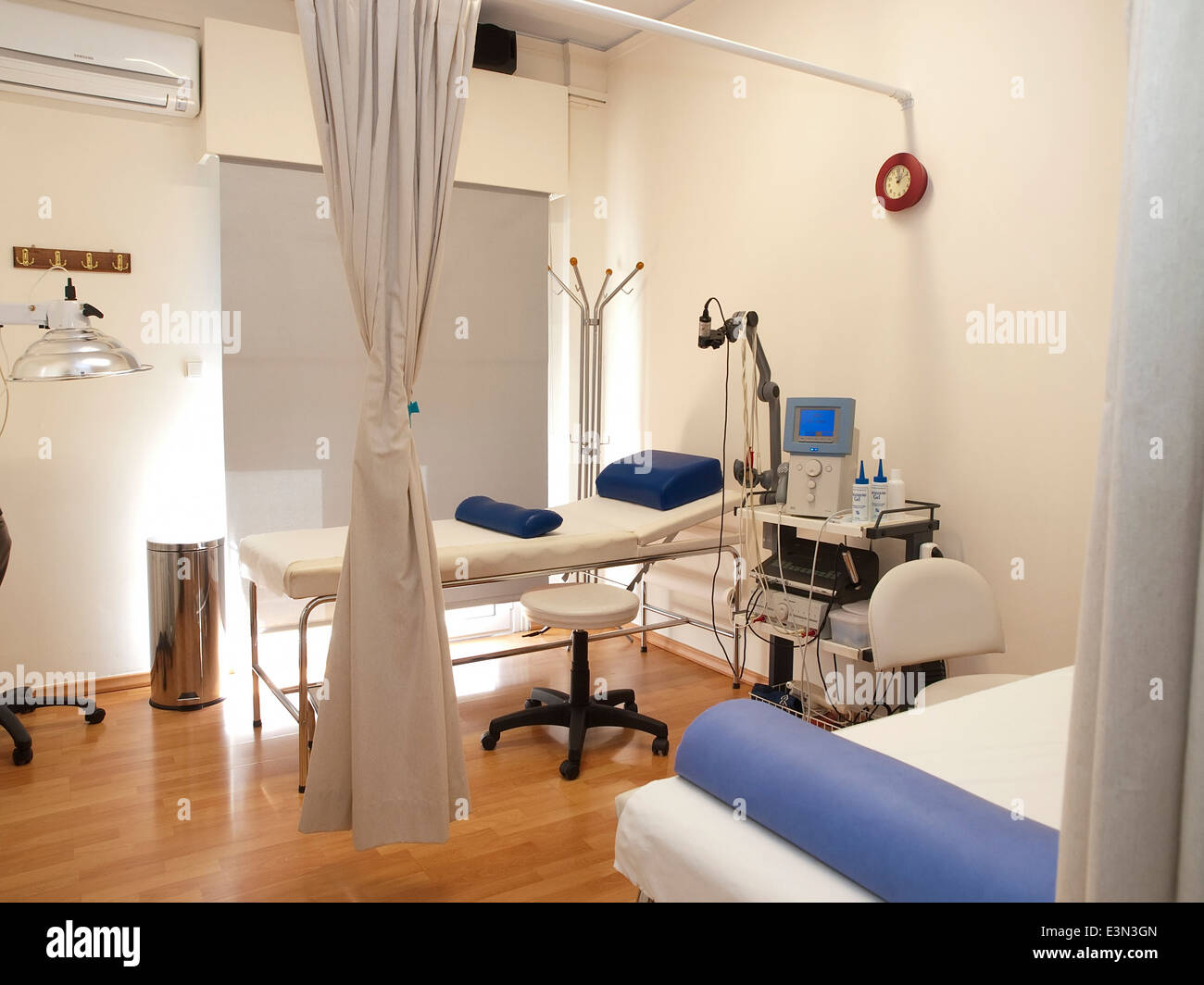 Physical therapy (physiotherapy) room with equipment - Stock Image