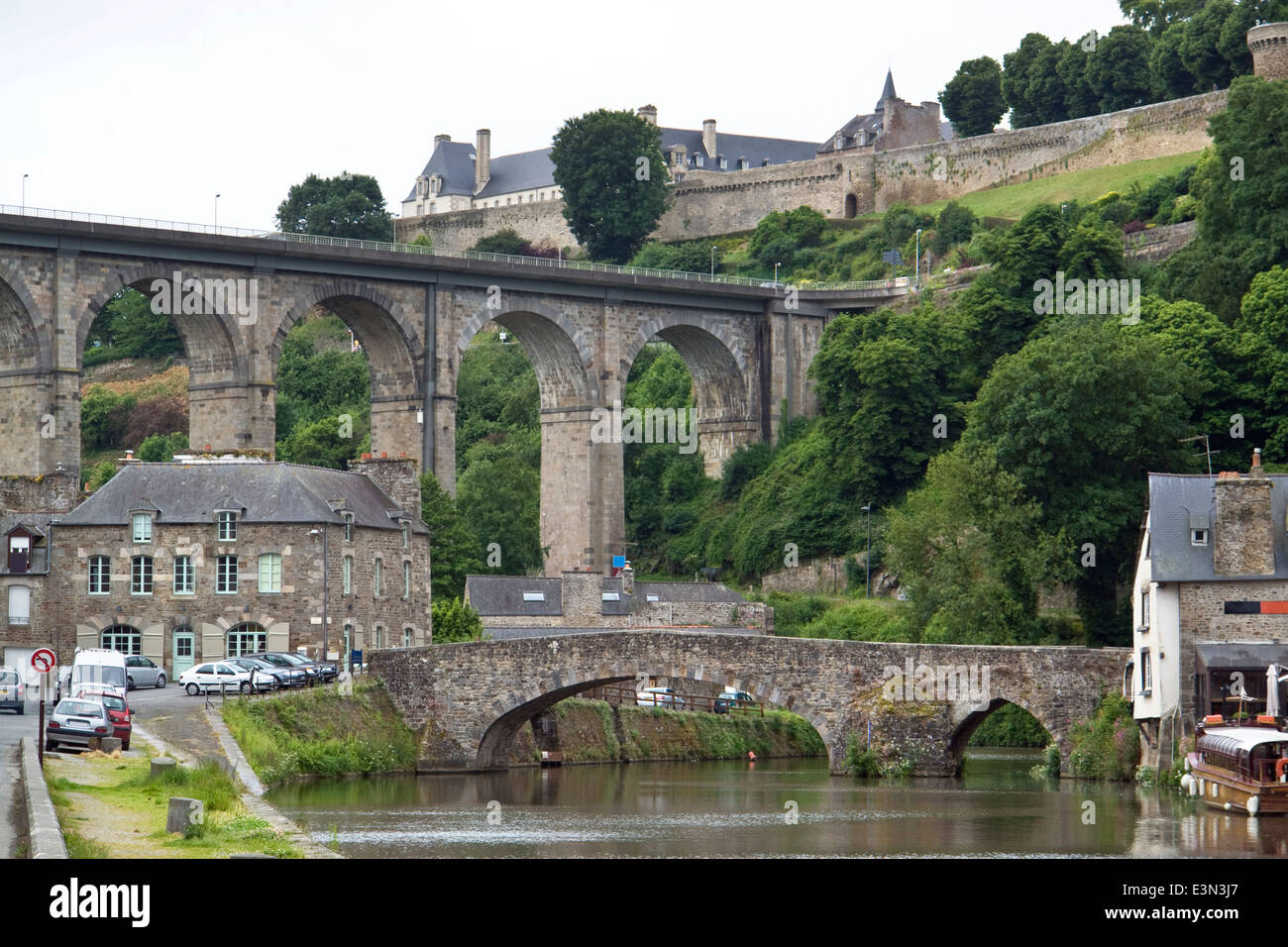 Idyllic scenery at the port of Dinan, a town in Brittany, France. It is located at the river Rance Stock Photo