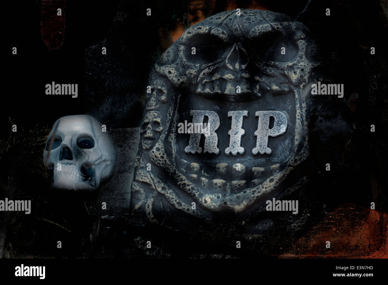 Halloween. Painterly grunge image of a graveyard headstone and skull. - Stock Image
