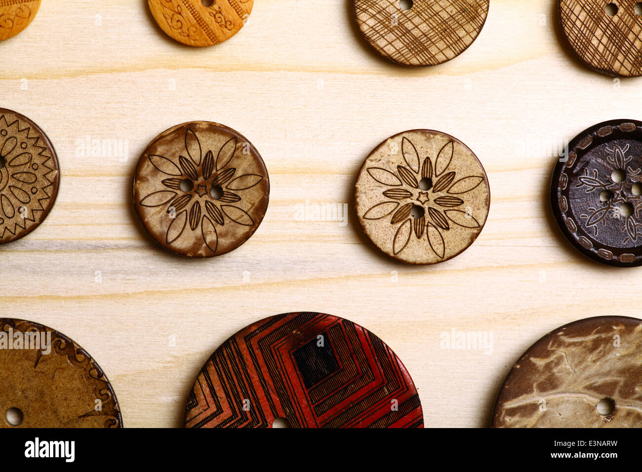 Close up color shot of some wooden buttons. - Stock Image