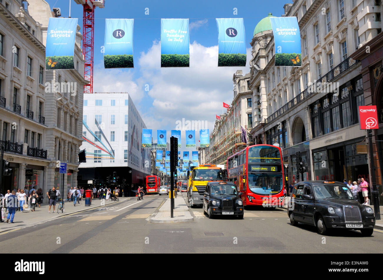 London, England, UK. Regent Street. Traffic and blue banners publicising 'Traffic Free Sundays in July' - Stock Image