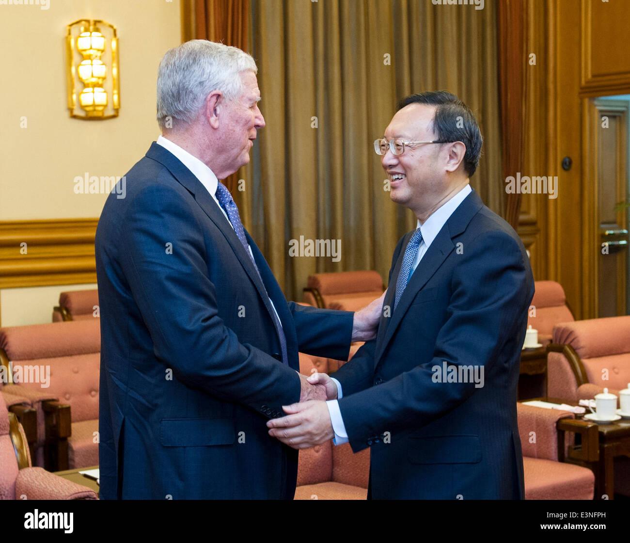 Beijing, China. 24th June, 2014. Chinese State Councilor Yang Jiechi (R) meets with a delegation from the American - Stock Image