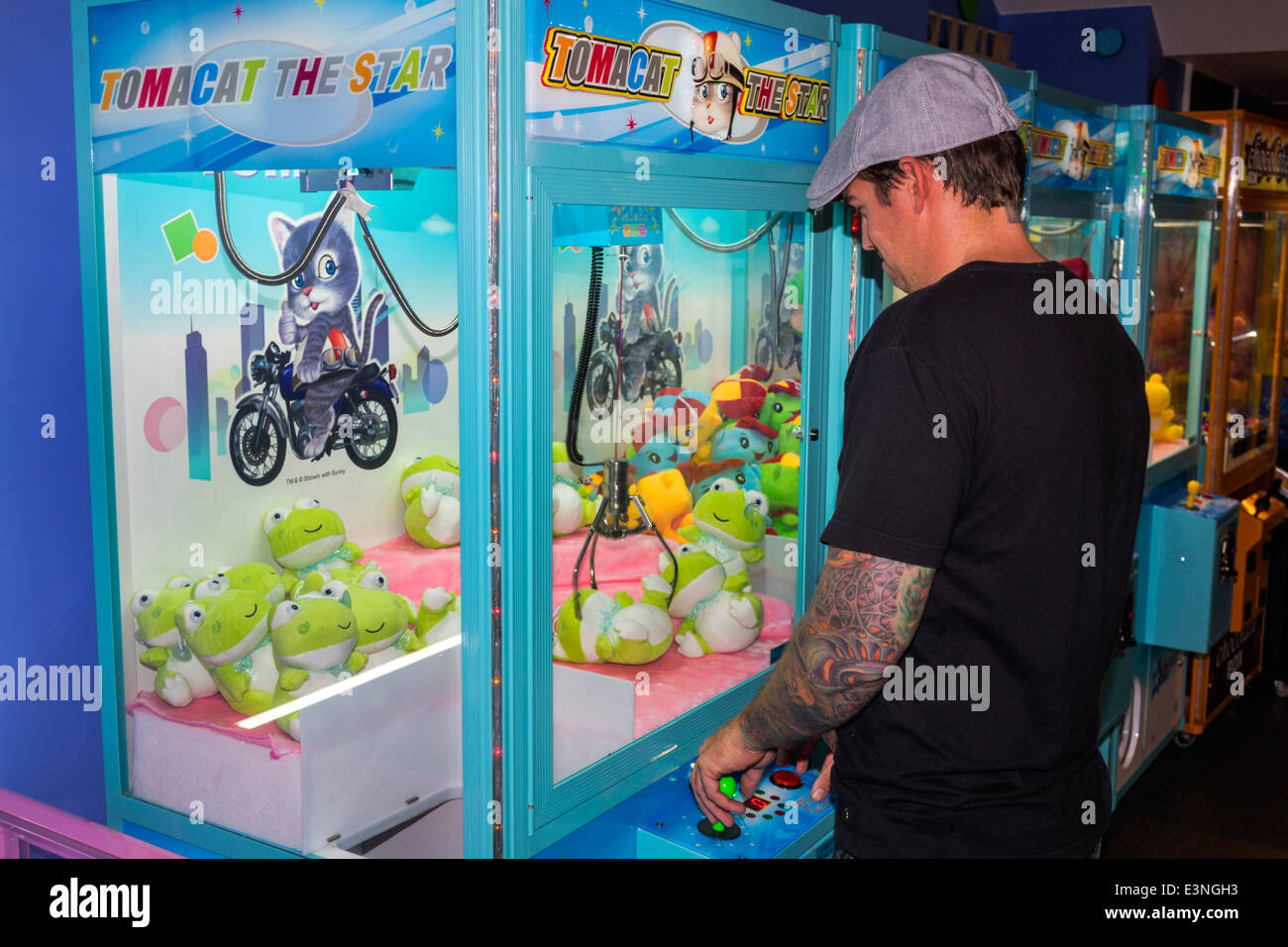 Brisbane Australia Queensland Fortitude Valley Metro Station game room claw stuffed animals man carnival trying - Stock Image
