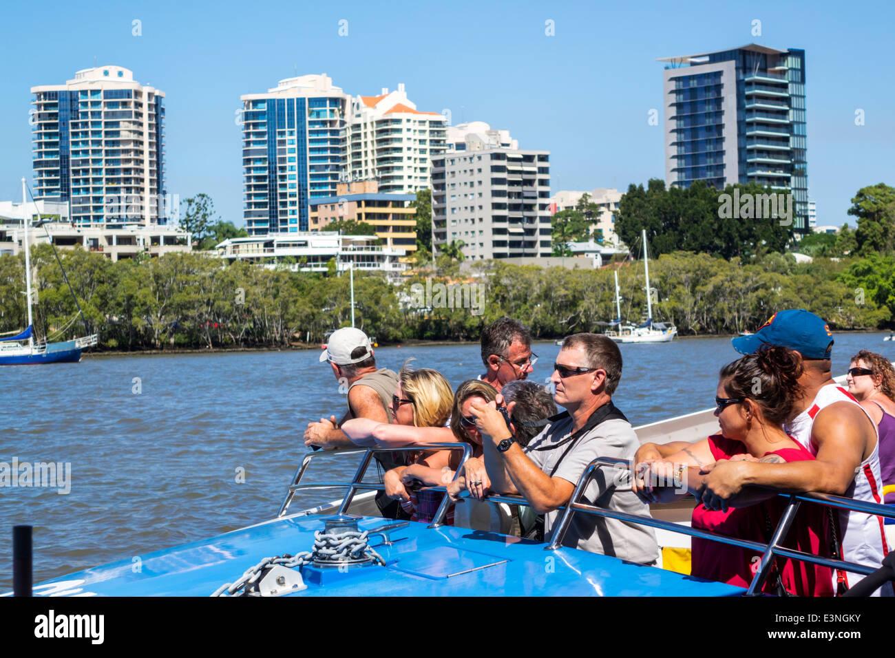 Brisbane Australia Queensland Kangaroo Point Brisbane River CityCat ferry boat public transportation riders passengers - Stock Image