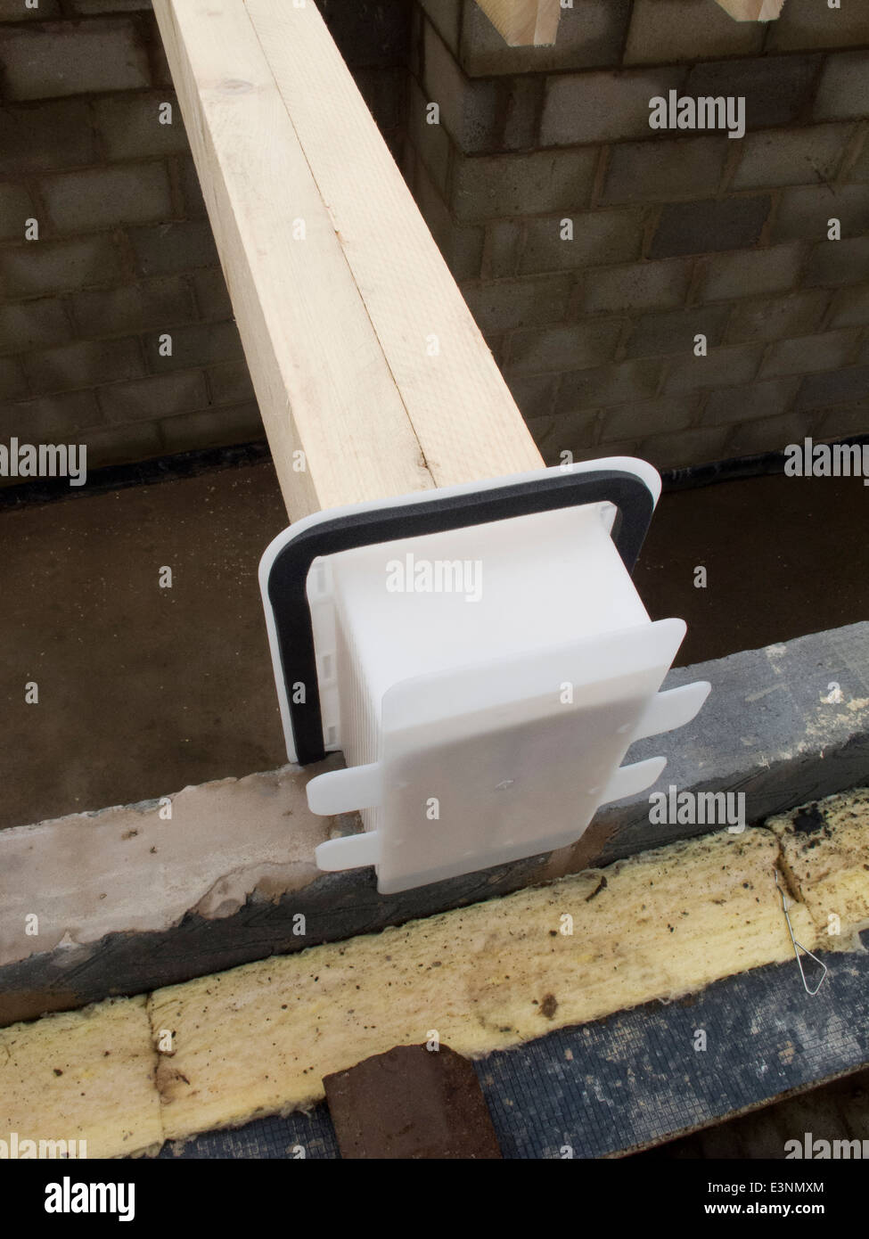self building house, first floor joist in Manthorpe joist seal pocket laid into position, - Stock Image
