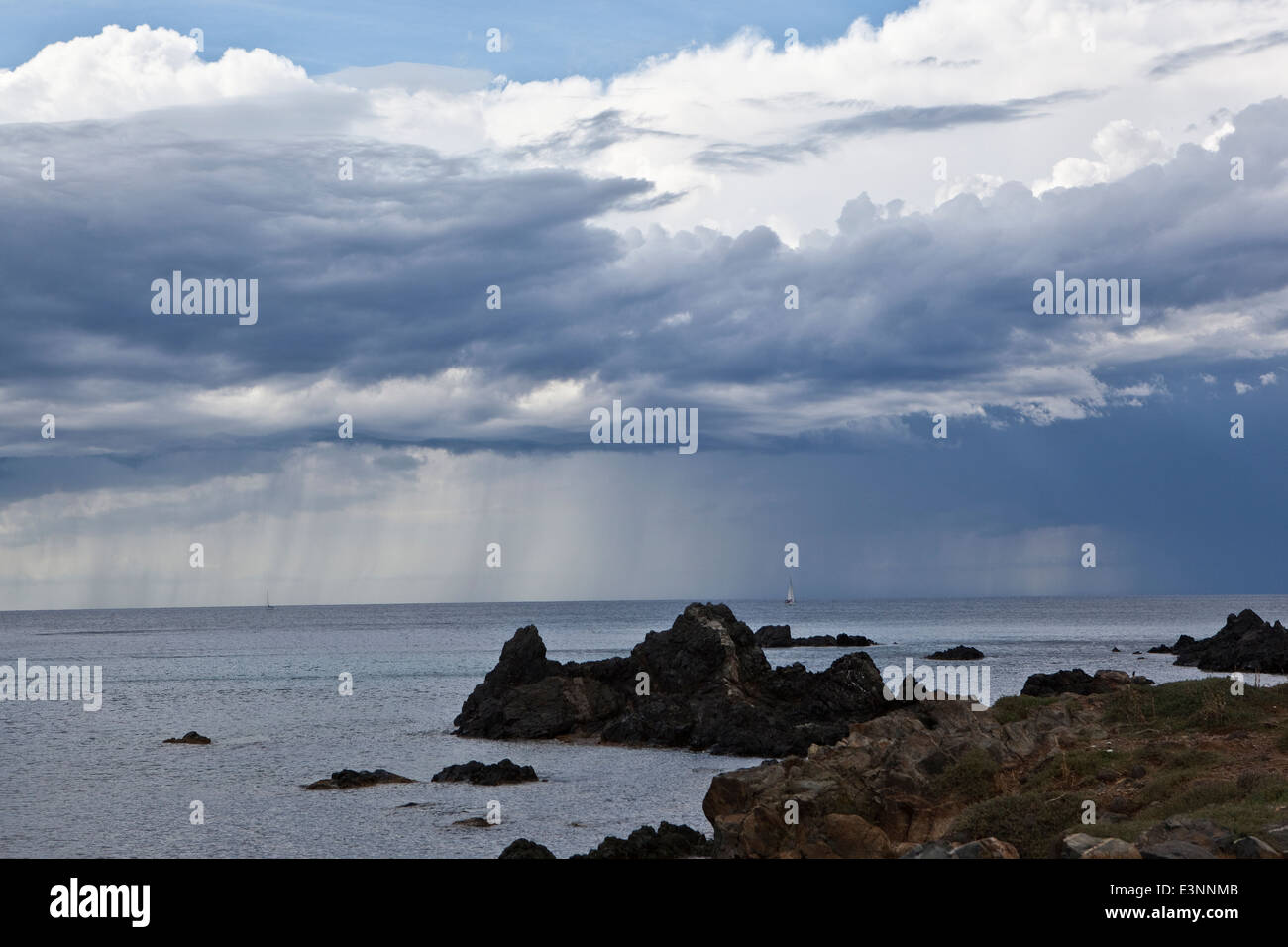 Sails under a squall out of Ajaccio (Corsica,France) - Stock Image