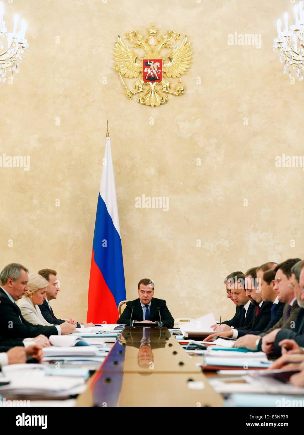 ITAR-TASS: MOSCOW, RUSSIA. JUNE 26, 2014. Russia's prime minister Dmitry Medvedev (C) holds a meeting of the government Stock Photo