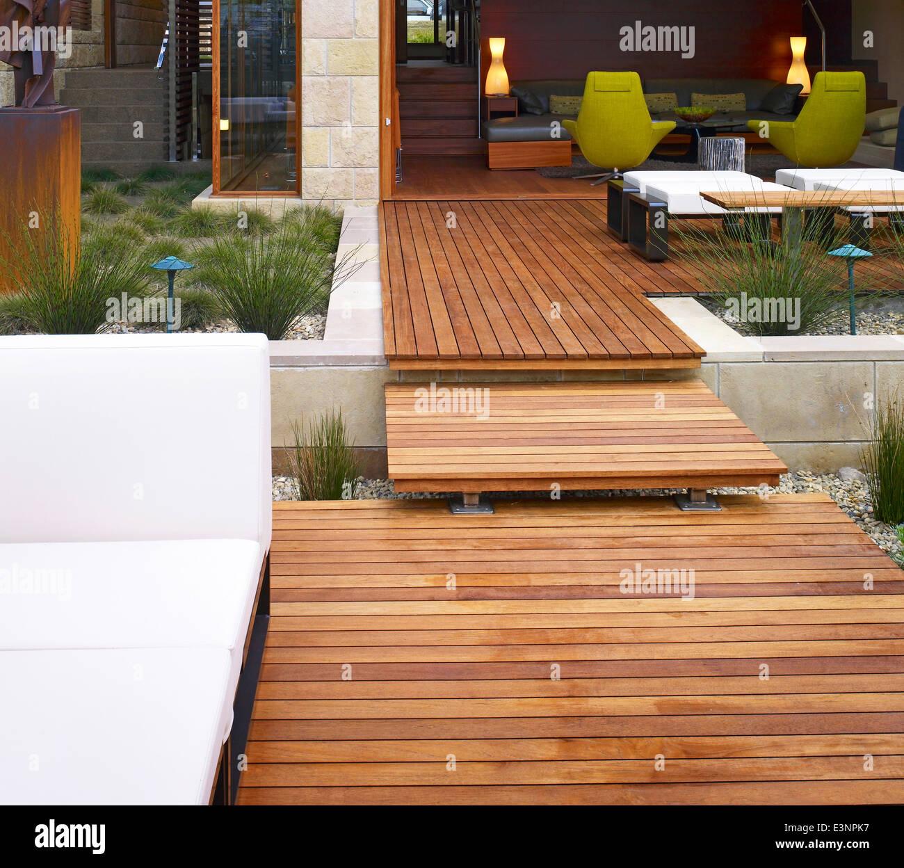 Split level terrace in garden of Odyssey House, Carmel, California, USA. - Stock Image