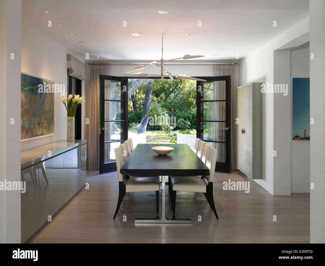 View through door to garden from dining area in Stone House Atherton California USA. & View through door to garden from dining area in Stone House Stock ...