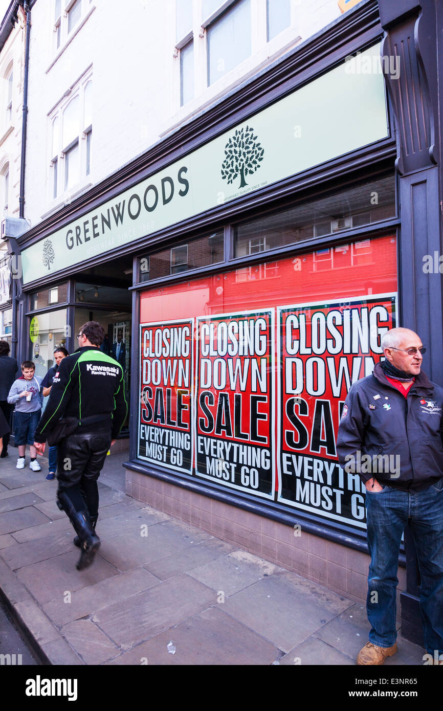 Greenwoods menswear closing down sale clothing shop store bankrupt building front window high street - Stock Image
