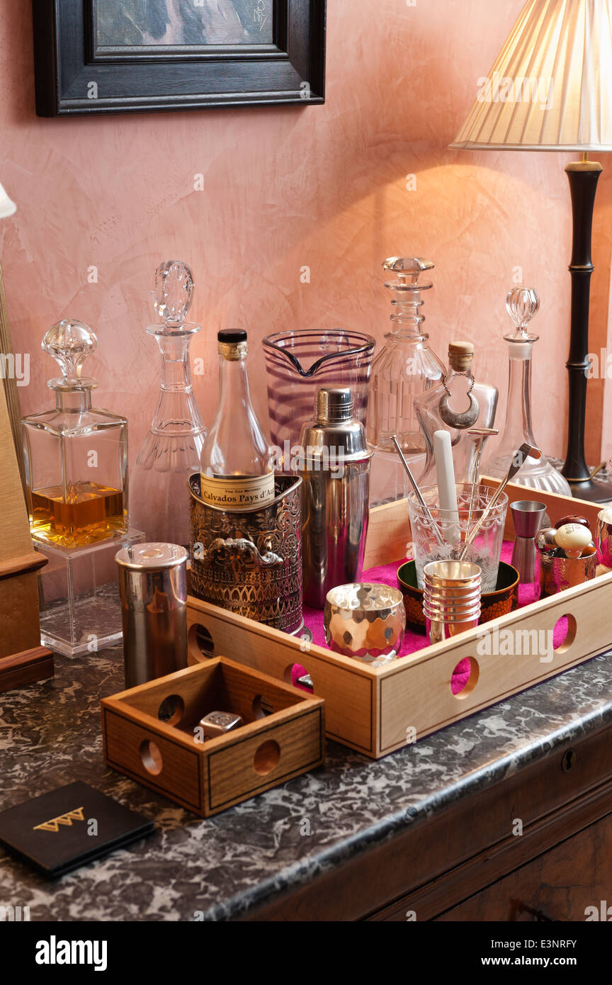 Glass decanters and cocktail mixer in a wooden drinks tray designed by Beckford - Stock Image