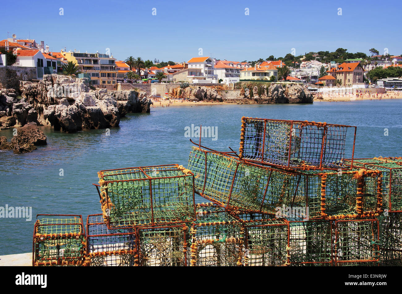 Fishing traps in a port and overall view of the beautiful touristic village of Cascais, Portugal. - Stock Image
