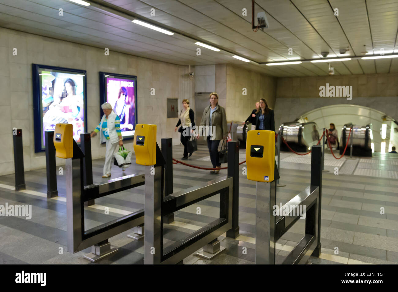 Commuters approaching the Validation ticket machines, Prague, Czech Republic. - Stock Image