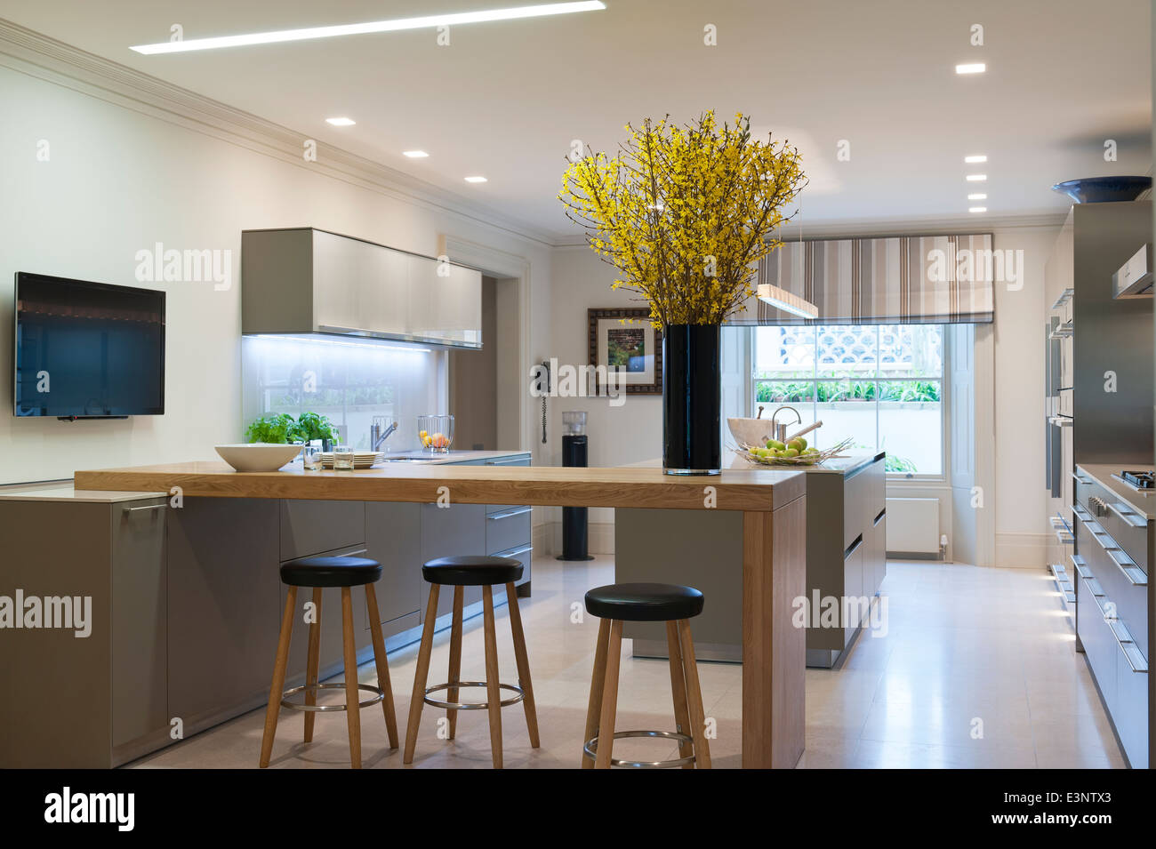 Modern bulthaup kitchen with breakfast bar and stools stock photo