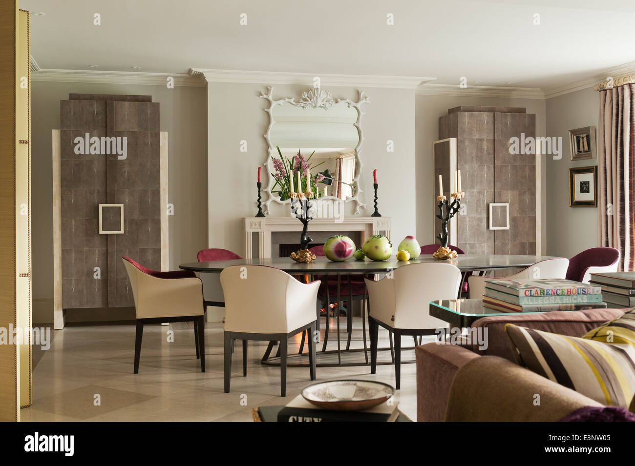 dining room with fire place and mirror - Stock Image