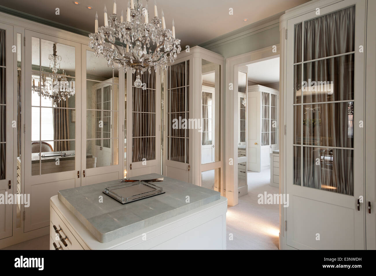 Cut glass chandelier in dressing room with glass and mirror panelled cut glass chandelier in dressing room with glass and mirror panelled wardrobes mozeypictures Images