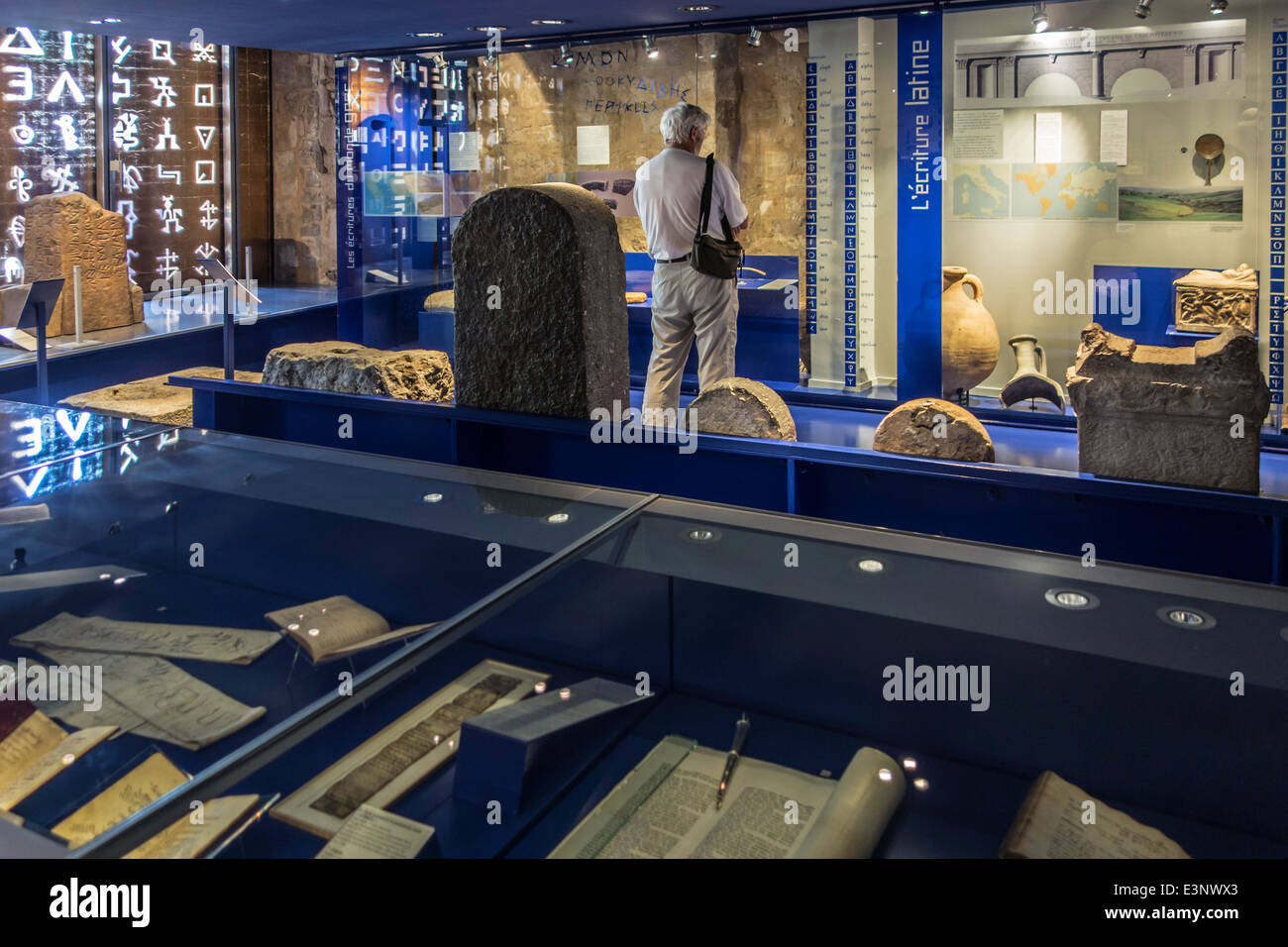Tourist visiting the museum Musée Champollion about ancient writings at Figeac, Lot, Midi-Pyrénées, - Stock Image