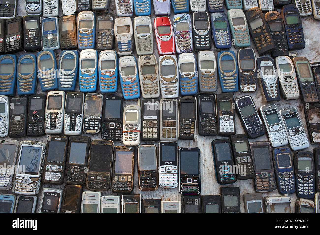 Old used mobile phones (cellphones) mostly Nokia for sale at the flea market in Ahmedabad, India. - Stock Image