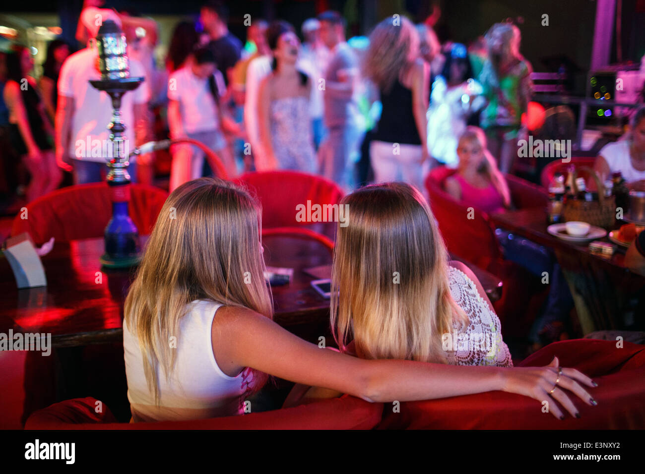Russian tourists at a party in a bar catering for Russians on Walking Street in Pattaya, Thailand - Stock Image