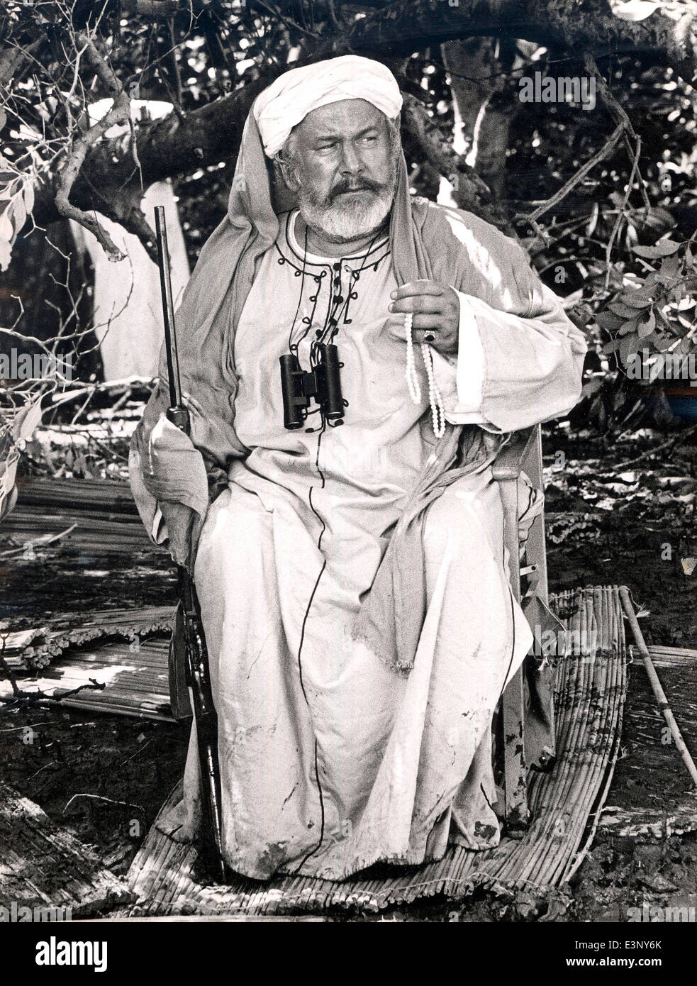 Sir Peter Ustinov (1921-2004) renowned actor playing an evil slave trader in the film Ashanti in Kenya in 1978 - Stock Image