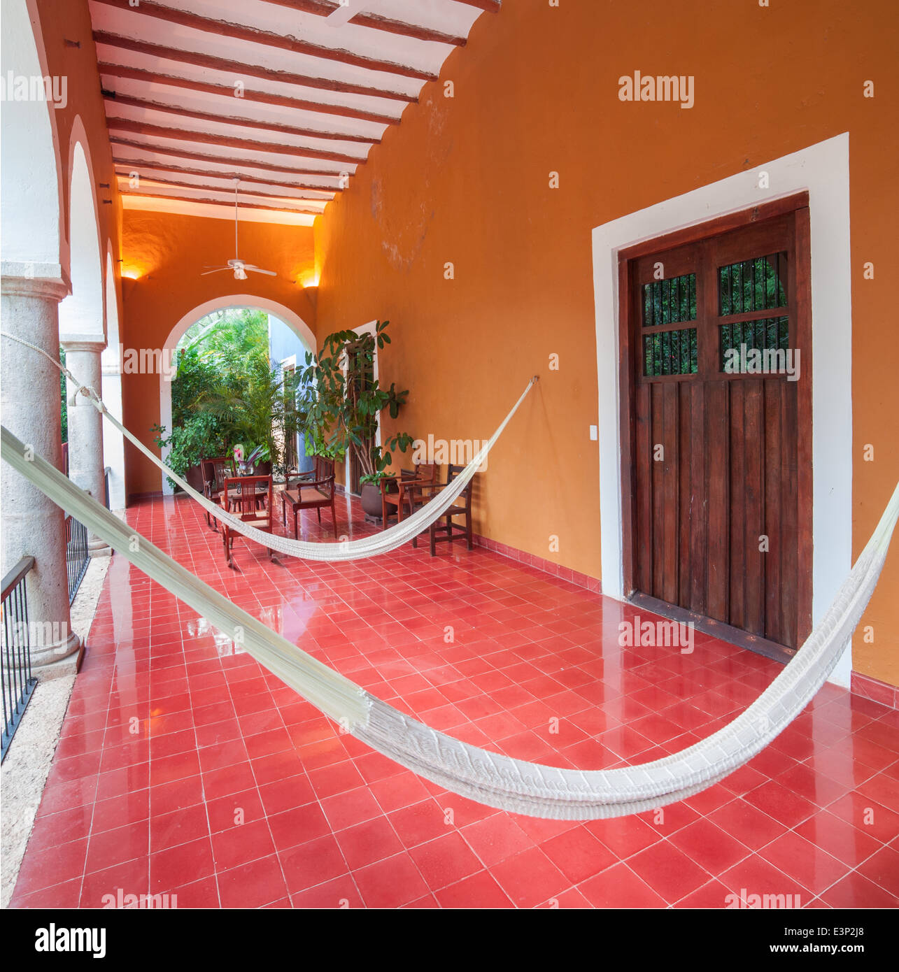 Hammocks hang in the patio of the San Jose Cholul hacienda in Yucatan, Mexico. - Stock Image