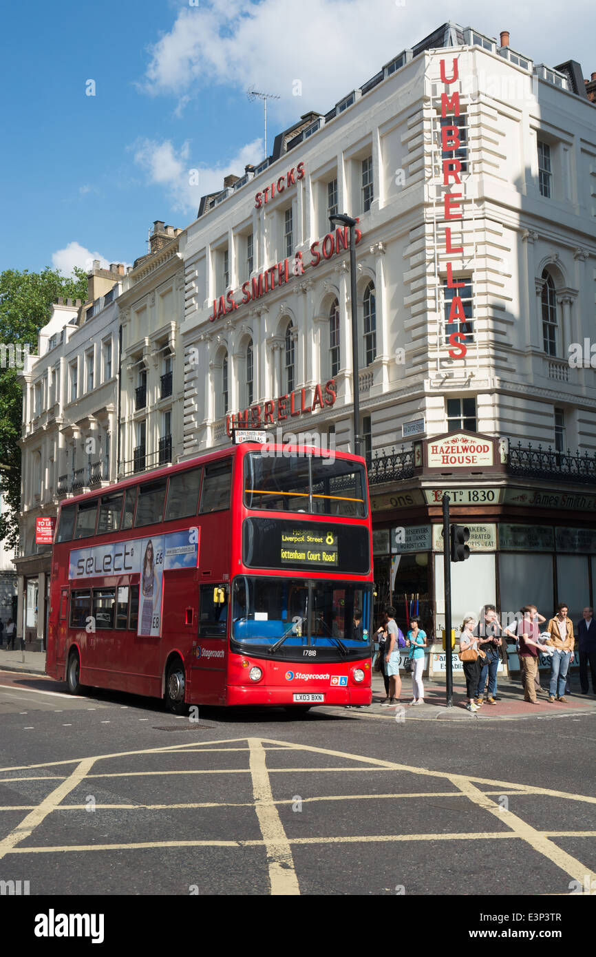 A Stagecoach London Transbus Trident with ALX400 bodywork passes the Umbrella shop in New Oxford Street, London - Stock Image