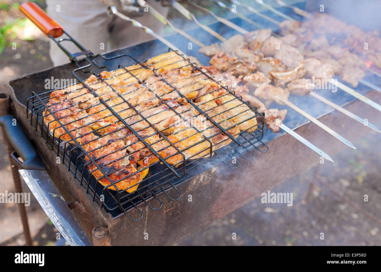 Appetizing fresh meat shish kebab prepared on a grill wood coal - Stock Image