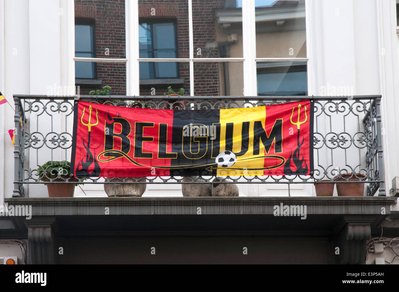 Fans of the Belgian Red Devils hang banners from the balconies of Ghent, ahead of World Cup 2014 matches - Stock Image