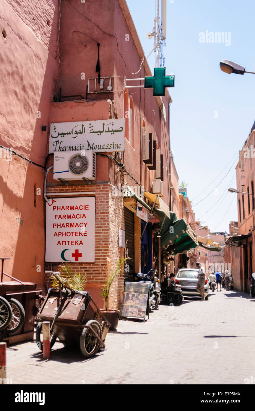 Sign saying 'Pharmacy, Pharmacie, Farmacia, Apteke' at a Chemist shop in Marrakech, Morocco - Stock Image