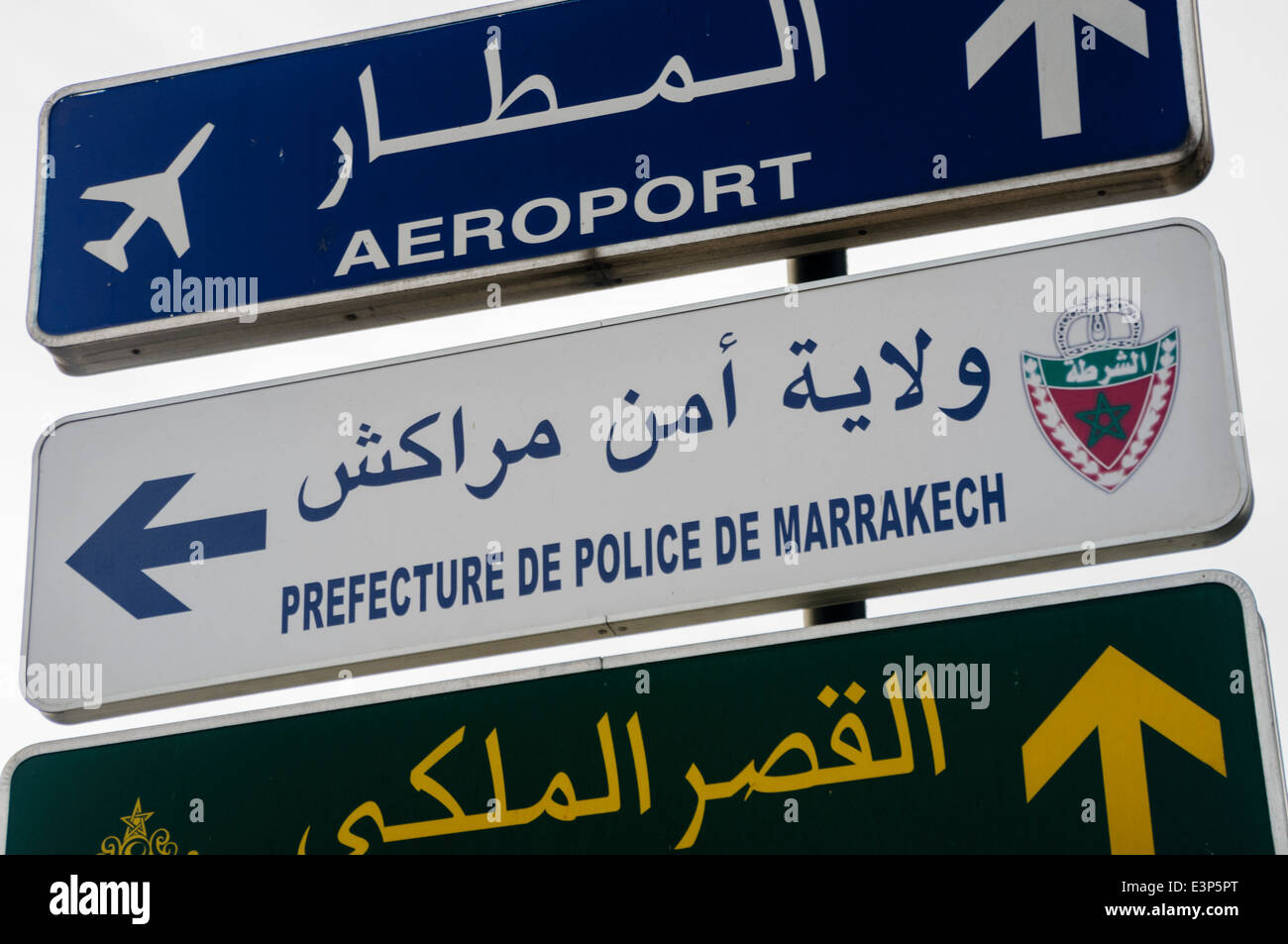 Signs for the Prefecture De Police de Marrakech, police station, and the Aeroport Menara International Airport, Stock Photo